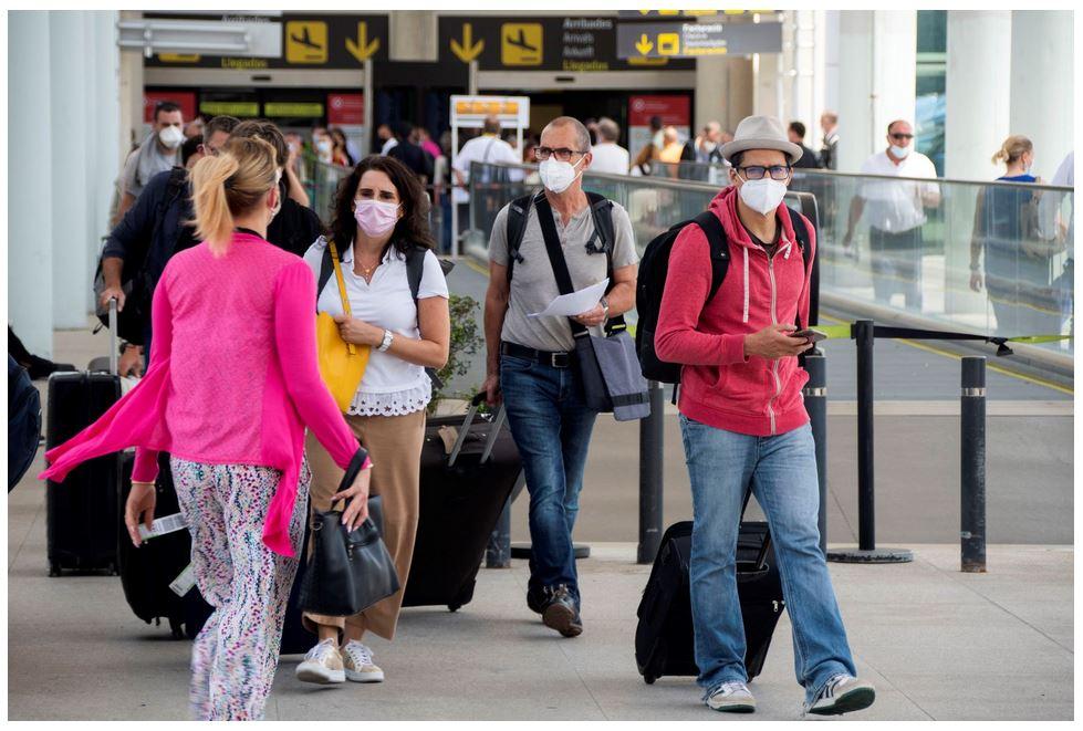 International travelers enter spain